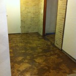 This is the floor after gluing down the paper on cement.