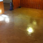 This is a section of the basement floor during the process of adding polyurethane.