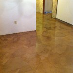 Another view of the basement floor after sealant.