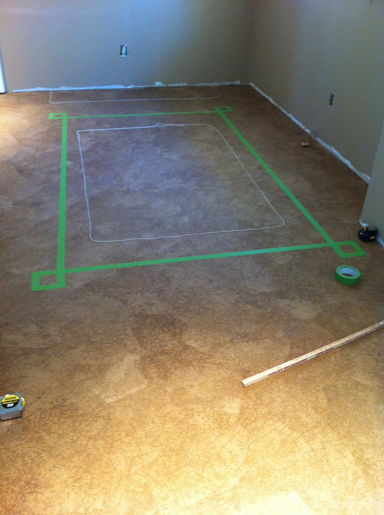 It starts with measuring the space I want to work around (yarn in center) and using painters tape to start a pattern.