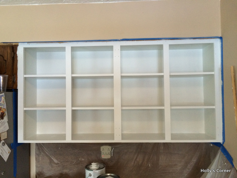 First (and only) needed coat of white latex paint over the primed surface.